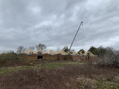 Roof trusses going in on construction site at Smarden