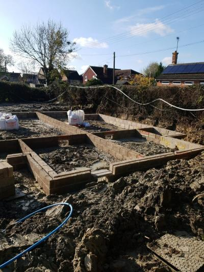 Groundworks Progressing for Construction Works of 8 New Terraced Houses at Burgess Hill, West Sussex